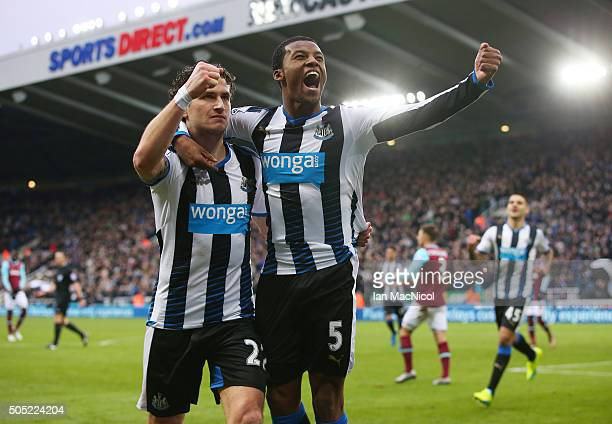 Georginio Wijnaldum of Newcastle United celebrates scoring his team's second goal with his team mate Daryl Janmaat during the Barclays Premier League...