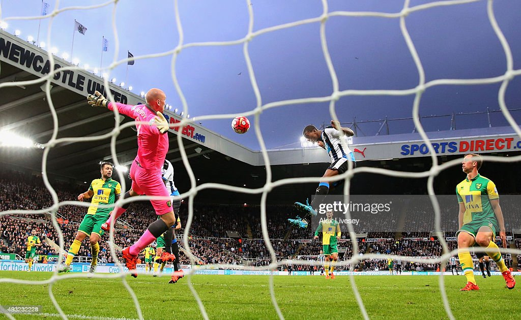 Georginio Wijnaldum of Newcastle United heads in their fifth goal past John Ruddy of Norwich City to complete his hat trick during the Barclays Premier League match between Newcastle United and Norwich City at St James' Park on October 18, 2015 in Newcastle upon Tyne, England.
