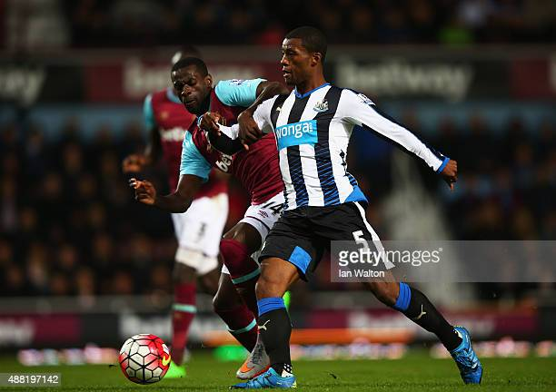 Georginio Wijnaldum of Newcastle United is challenged by Pedro Obiang of West Ham United during the Barclays Premier League match between West Ham...