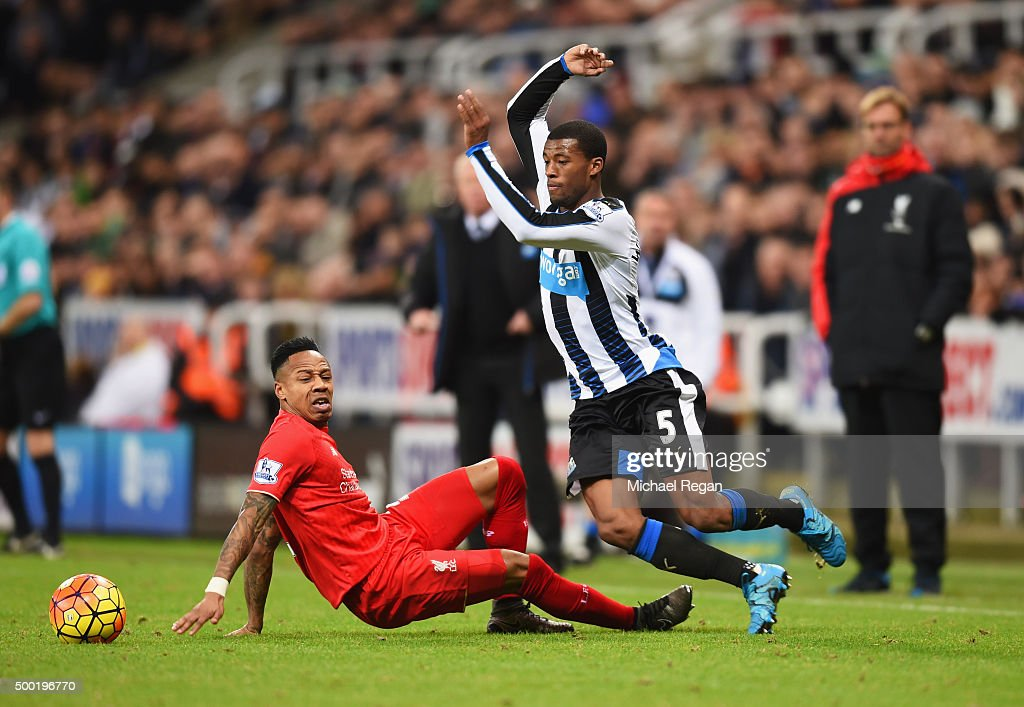 Georginio Wijnaldum of Newcastle United skips past Nathaniel Clyne of Liverpool during the Barclays Premier League match between Newcastle United and Liverpool at St James' Park on December 6, 2015 in Newcastle upon Tyne, England