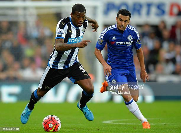 Georginio Wijnaldum of Newcastle United under pressure from Pedro of Chelsea during the Barclays Premier League match between Newcastle United and...