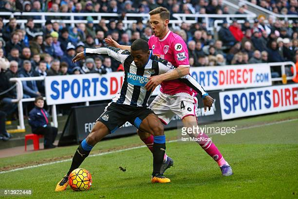 Georginio Wijnaldum of Newcastle United vies with Dan Gosling of Bourenmouth during the Barclays Premier League match between Newcastle United and...
