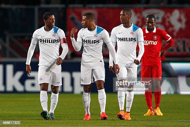 Georginio Wijnaldum of PSV celebrates after he scores the third goal of the game for his team with Luciano Narsingh and Joshua Brenet during the...