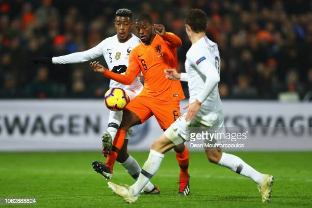 Georginio Wijnaldum of the Netherlands battles for the ball with Benjamin Pavard and Presnel Kimpembe of France during the UEFA Nations League A...