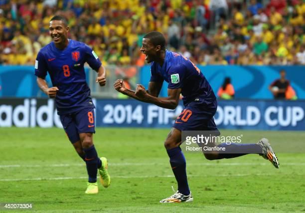 Georginio Wijnaldum of the Netherlands celebrates scoring his team's third goal with Jonathan de Guzman during the 2014 FIFA World Cup Brazil Third...