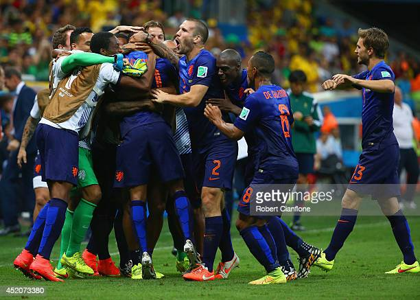 Georginio Wijnaldum of the Netherlands celebrates scoring his team's third goal with teammates during the 2014 FIFA World Cup Brazil Third Place...