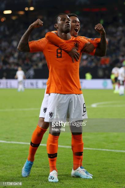 Georginio Wijnaldum of the Netherlands celebrates with teammate Donyell Malen after scoring his team's fourth goal during the UEFA Euro 2020...