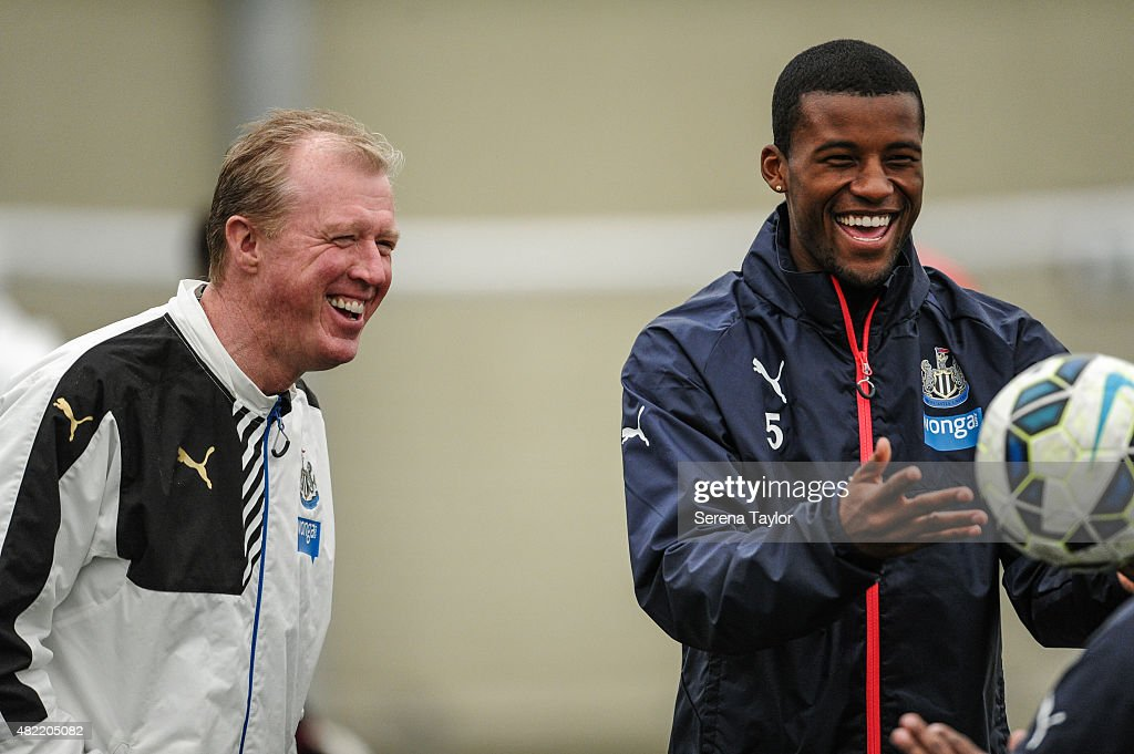 Georginio Wijnaldum (R) throws the ball whilst Head Coach Steve McClaren (L) laughs during the Newcastle United Pre-Season Training session at The Newcastle United Training Centre on July 28, 2015, in Newcastle upon Tyne, England.