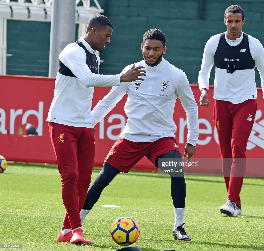 Georginio Wijnaldum with Joe Gomez of Liverpool during a training session at Melwood Training Ground on March 13, 2018 in Liverpool, England.