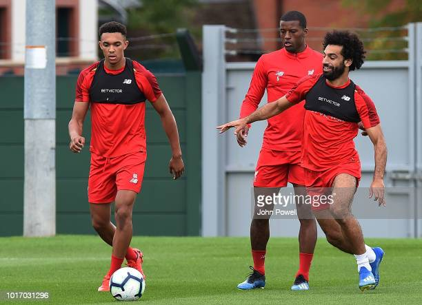 Georginio Wijnaldum with Mohamed Salah and Trent AlexanderArnold of Liverpool during a training session at Melwood Training Ground on August 15 2018...
