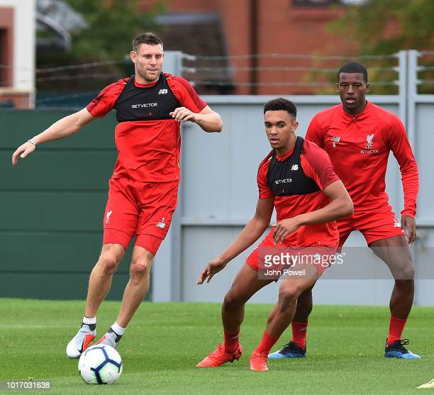 Georginio Wijnaldum with Trent AlexanderArnold and James Milner of Liverpool during a training session at Melwood Training Ground on August 15 2018...