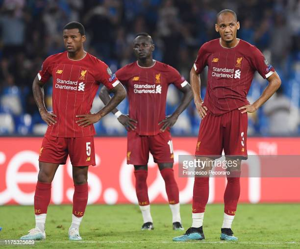 Georgino Wijnaldum and Fabinho of Liverpool FC stand disappointed during the UEFA Champions League group E match between SSC Napoli and Liverpool FC...