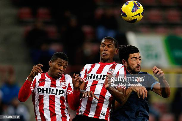 Georgino Wijnaldum and Marcelo Antonio Guedes Filho of PSV and Graziano Pelle of Feyenoord battle for the header during the KNVB Dutch Cup match...