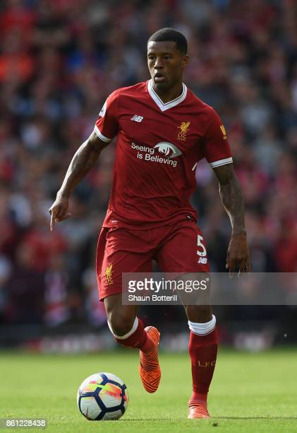 Georgino Wijnaldum of Liverpool runs with the ball during the Premier League match between Liverpool and Manchester United at Anfield on October 14...