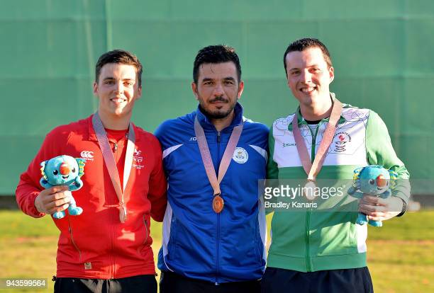 Georgios Achilleos of Cyprus wins a gold medal with Ben Llewellin of Wales winning silver and Gareth McAuley of Northern Ireland winning bronze in...