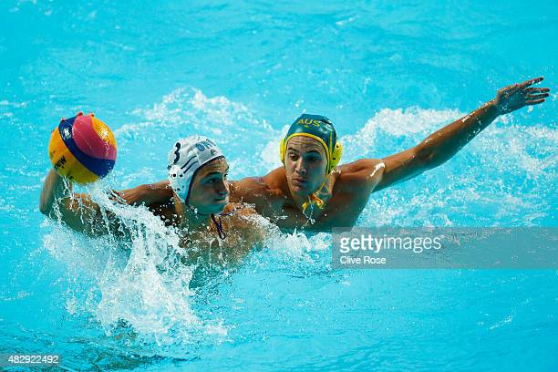 Georgios Dervisis of Greece is challenged by Aiden Roach of Australia in the Men's Water Polo QuarterFinal match between Greece and Australia on day...