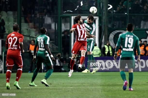 Georgios Koutroubis of Panathinaikos in action against Karim Ansarifard of Olympiacos during Superleague Greece match between Panathinaikos and...