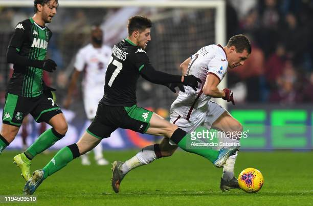 Georgios Kryriakopoulos of US Sassuolo competes for the ball with Andrea Belotti of Torino FC during the Serie A match between US Sassuolo and Torino...