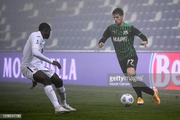 Georgios Kyriakopoulos of US Sassuolo is challenged by Wilfried Singo of Torino FC during the Serie A football match between US Sassuolo and Torino...