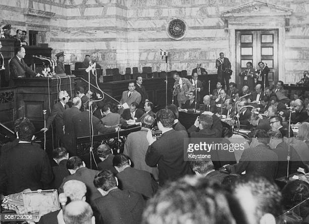 Georgios Papadopoulos the new Greek Prime Minister addressing the press from a lectern in Parliament as he and the Greek Junta ask King Constantine...