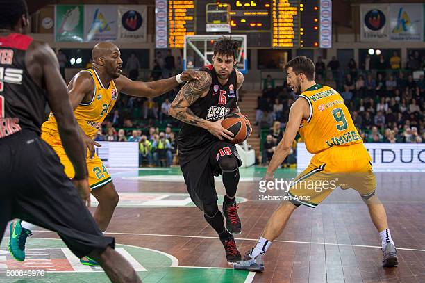 Georgios Printezis #15 of Olympiacos Piraeus competes with Ali Traore #24 of Limoges CSP and Leo Westermann #9 of Limoges CSP during the Turkish...