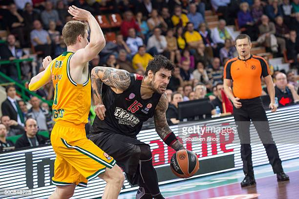 Georgios Printezis #15 of Olympiacos Piraeus competes with Mark Payne #11 of Limoges CSP during the Turkish Airlines Euroleague Basketball Regular...