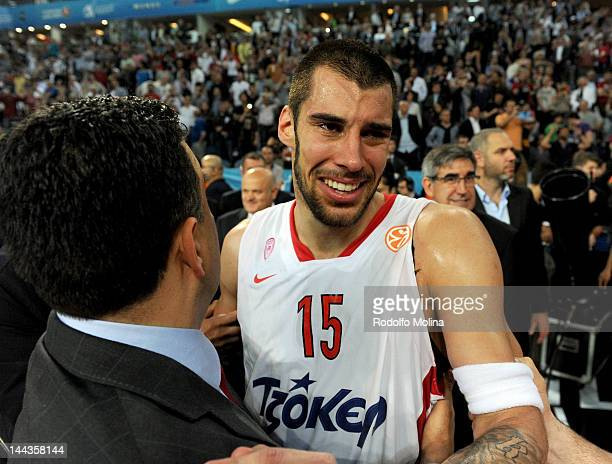 Georgios Printezis #15 of Olympiacos Piraeus is congratulated after scoring the winning basket during the Turkish Airlines EuroLeague Final Four...