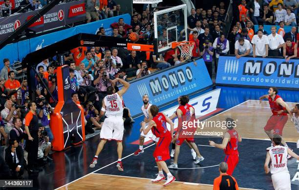 Georgios Printezis #15 of Olympiacos Piraeus scores the winning basket during the Turkish Airlines EuroLeague Final Four Final match between CSKA...