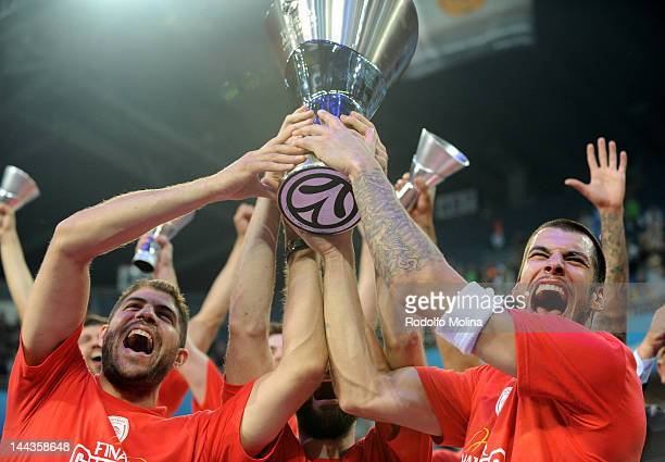 Georgios Printezis of Olympiacos Piraeus lifts the trophy after scoring the winning basket at the end of the Turkish Airlines EuroLeague Final Four...