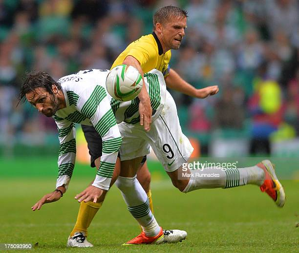 Georgios Samaras of Celtic and Anders Svensson of Elfsborg collide in midfield during the UEFA Champions League Third Qualifying Round First Leg...