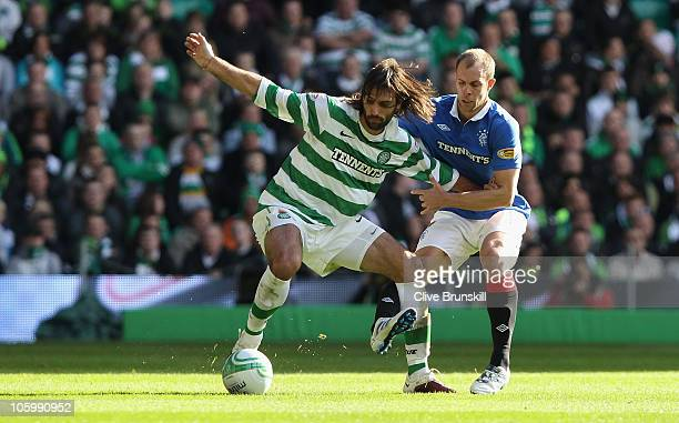Georgios Samaras of Celtic holds off a challenge from Steven Whittaker of Rangers during the Clydesdale Bank Premier League match between Celtic and...
