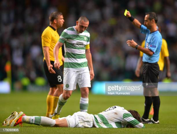 Georgios Samaras of Celtic lies on the ground after a tackle by Anders Svensson of Elfsborg who received a yellow card for the challenge during the...