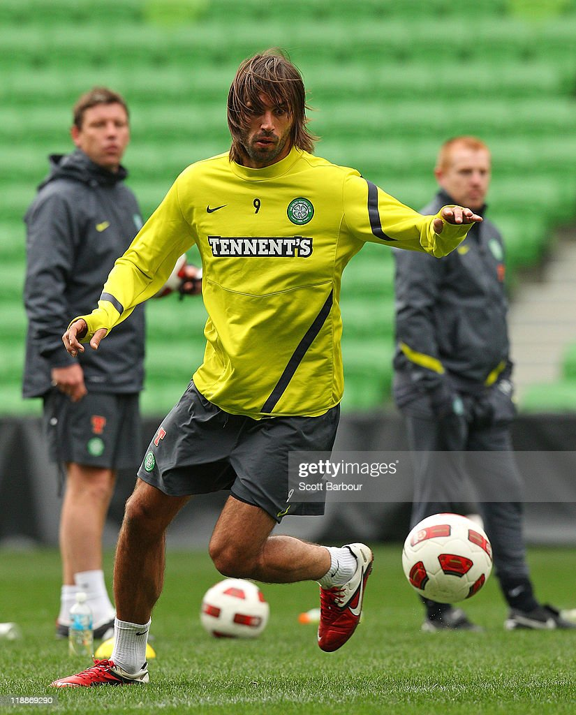 Georgios Samaras (C) of Celtic passes the ball as Neil Lennon (R), manager of Celtic FC looks on during a Glasgow Celtic training session at AAMI Park on July 12, 2011 in Melbourne, Australia.