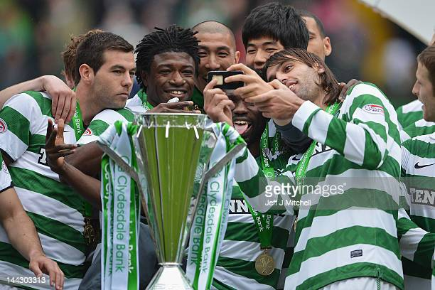 Georgios Samaras of Celtic takes a photo on a mobile phone as he and team mates celebrate victory in the Clydesdale Bank Premier League match between...