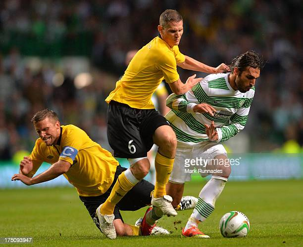 Georgios Samaras of Celtic takes on Anders Svensson and Jon Jonsson of Elfsborg collide in midfield during the UEFA Champions League Third Qualifying...