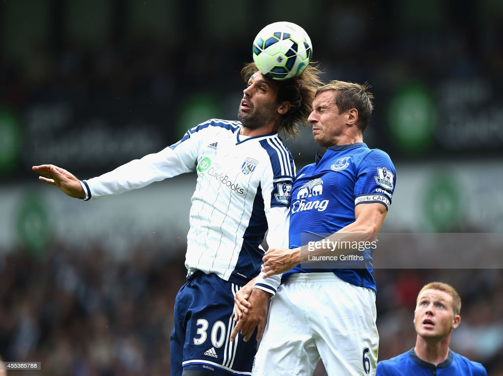 Georgios Samaras of West Bromwich Albion battles with Phil Jagielka of Everton during the Barclays Premier League match between West Bromwich Albion and Everton at The Hawthorns on September 13, 2014 in West Bromwich, England.