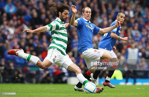 Georgious Samaras of Celtic tackles Steven Whittaker of Rangers during the Cooperative Insurance Cup Final between Celtic and Rangers at Hampden Park...