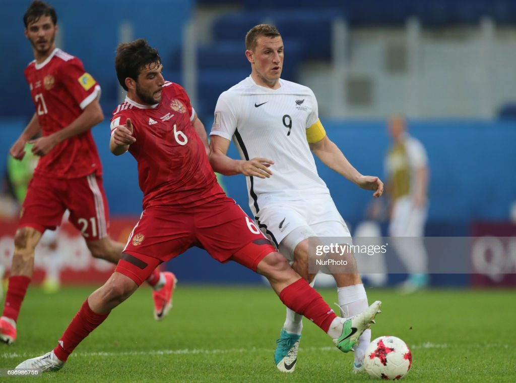 Georgiy Dzhikiya (L) of the Russian national football team and Chris Wood of the New Zealand national football team vie for the ball during the 2017 FIFA Confederations Cup match, first stage - Group A between Russia and New Zealand at Saint Petersburg Stadium on June 17, 2017 in St. Petersburg, Russia.