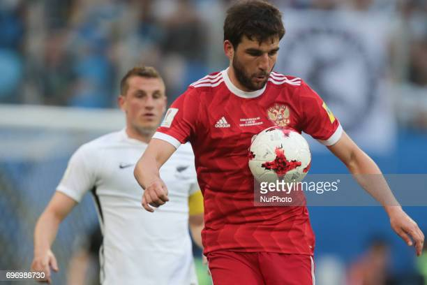 Georgiy Dzhikiya of the Russian national football team vie for the ball during the 2017 FIFA Confederations Cup match first stage Group A between...