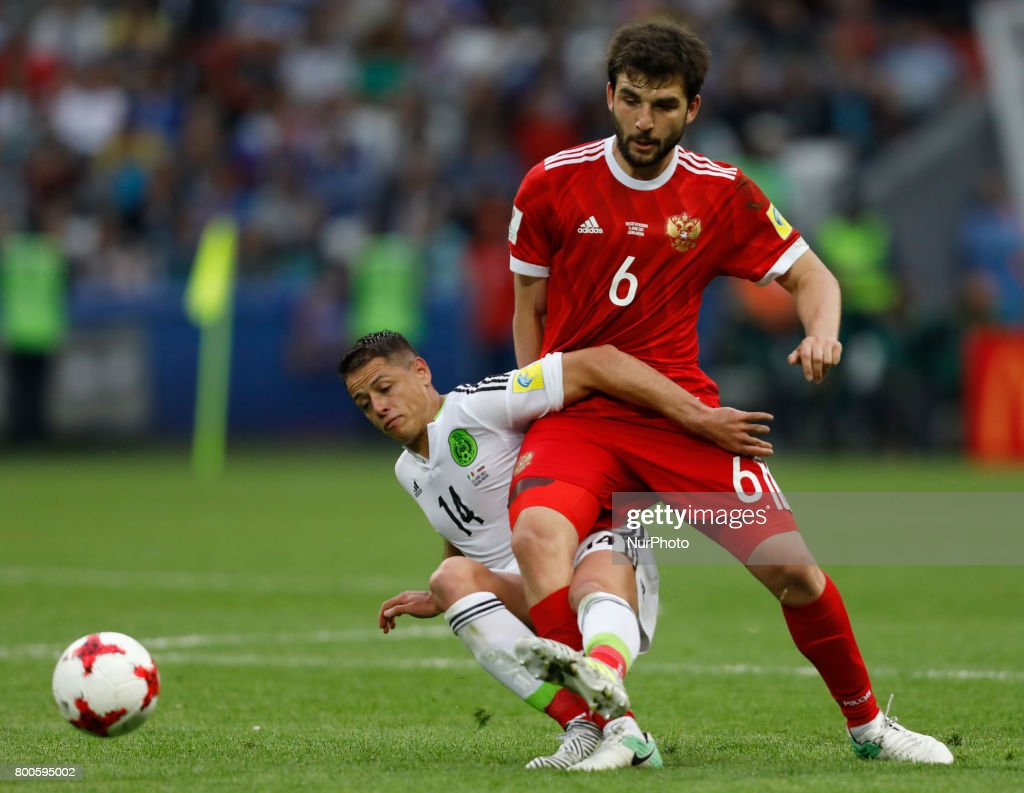 Georgy Dzhikya (R) of Russia national team and Javier Hernandez of Mexico national team vie for the ball during the Group A - FIFA Confederations Cup Russia 2017 match between Russia and Mexico at Kazan Arena on June 24, 2017 in Kazan, Russia.