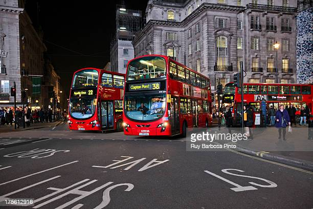 CONTENT] Geotagged photo taken at Regent Street St James's London City of Westminster England UK showing the red buses of london at night next to...