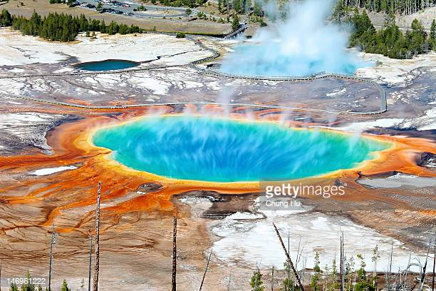 geothermal pool with steam rising - volcano stock pictures, royalty-free photos & images
