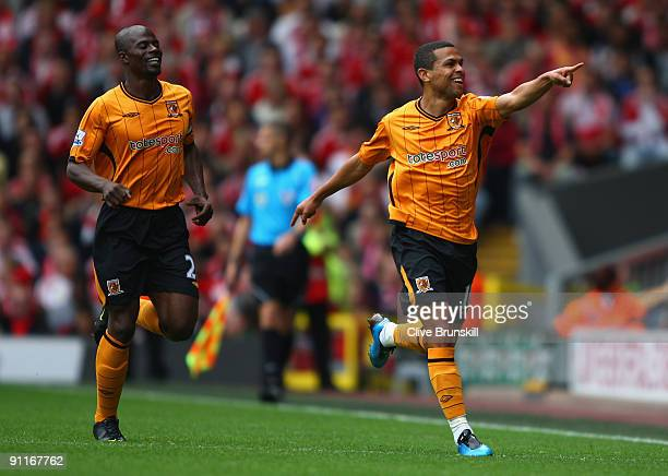 Geovanni of Hull City celebrates scoring his team's first goal with team mate George Boateng during the Barclays Premier League match between...