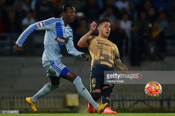Geovanny Nazareno of Emelec struggles for the ball with Victor Sosa of Pumas during the group 7 match between Pumas UNAM and Emelec as part of Copa...