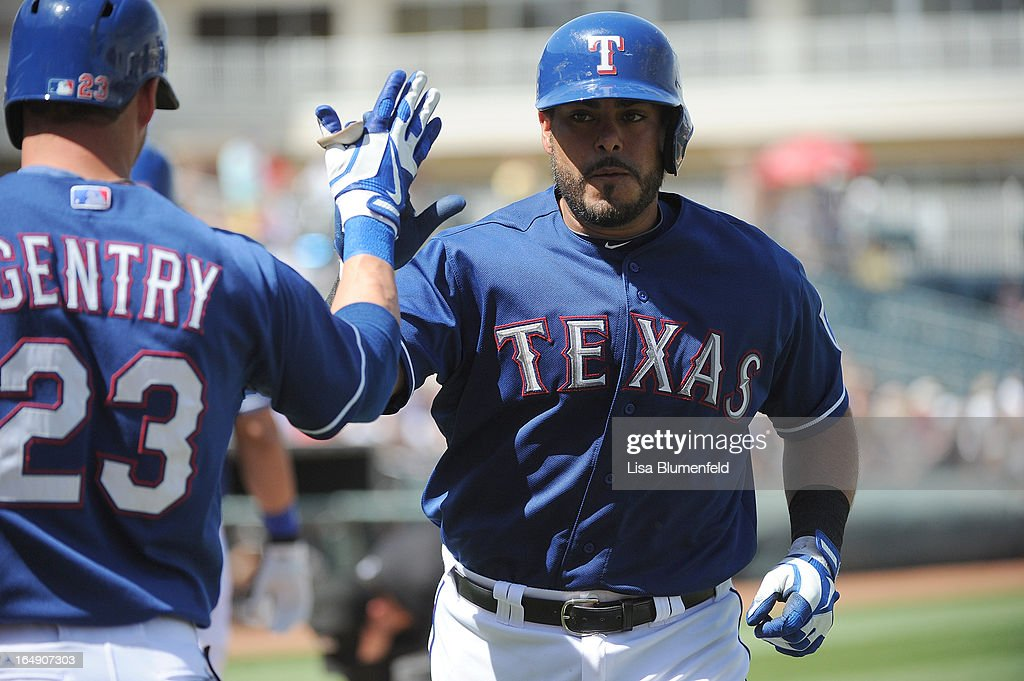 Geovany Soto #8 celebrates with teammate Craig Gentry #23 of the Texas Rangers after hitting a homerun against the Chicago White Sox at Surprise Stadium on March 26, 2013 in Surprise, Arizona.