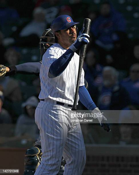 Geovany Soto of the Chicago Cubs reacts after striking out in the 9th inning against the Milwaukee Brewers at Wrigley Field on April 11 2012 in...