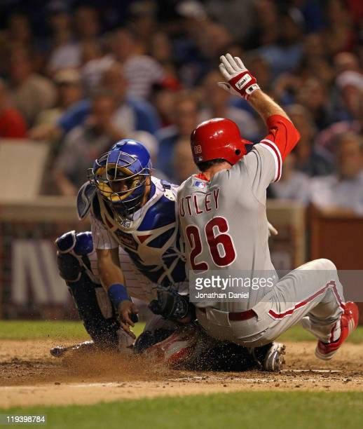 Geovany Soto of the Chicago Cubs tags out Chase Utley of the Philadelphia Phillies in the 8th inning at Wrigley Field on July 19 2011 in Chicago...