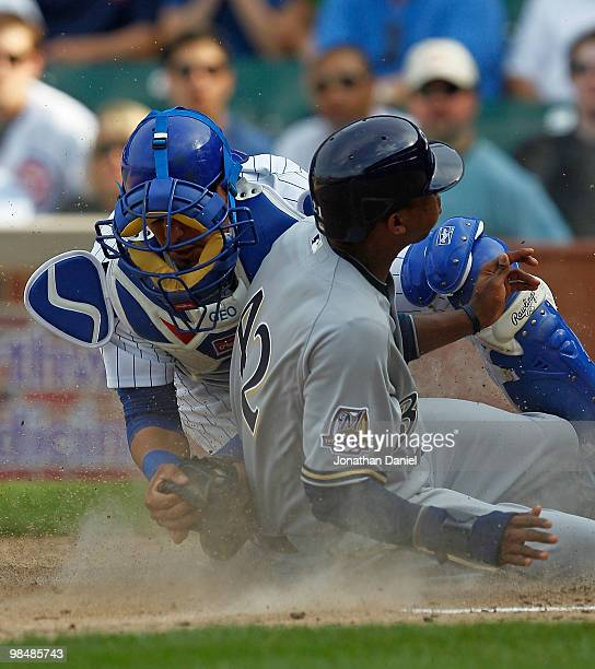 Geovany Soto of the Chicago Cubs wearing a number 42 jersey in honor of Jackie Robinson tags out Alcides Escobar of the Milwaukee Brewers also...