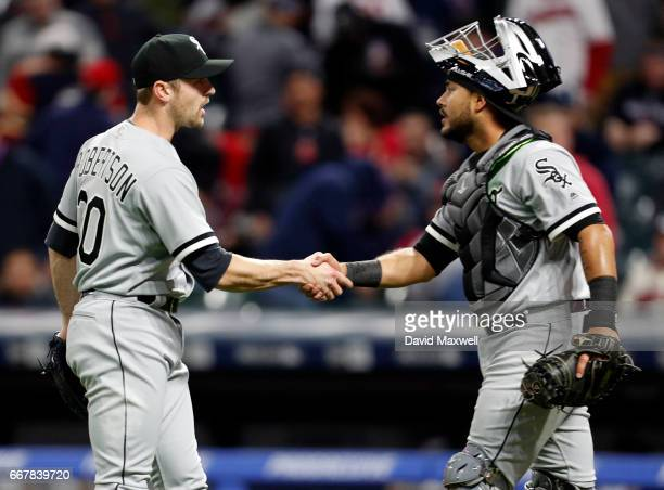 Geovany Soto of the Chicago White Sox congratulates closer David Robertson after the final out against the Cleveland Indians at Progressive Field on...