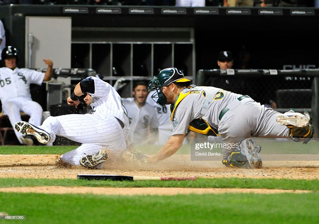 Geovany Soto #58 of the Chicago White Sox scores the winning run as Carson Blair #39 of the Oakland Athletics makes a late tag during the fourteenth inning on September 15, 2015 at U.S. Cellular Field in Chicago, Illinois. The White Sox won 8-7 in fourteen innings.